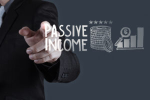 Business Man pointing to passive income and graph